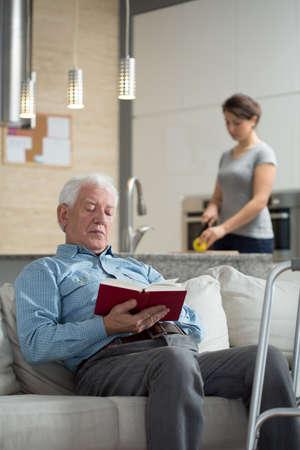 duties: Granddaughter helping disabled grandpa in domestic duties