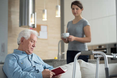 geriatric: Image of granddaughter helping her disabled grandpa