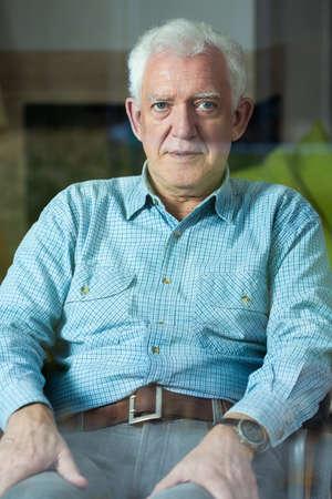 eldercare: Vertical view of elegant senior man on wheelchair Stock Photo