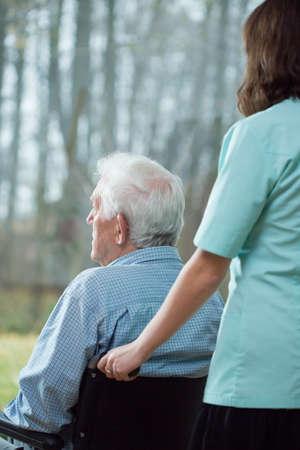 senior depression: Lonely senior man staying in nursing home Stock Photo