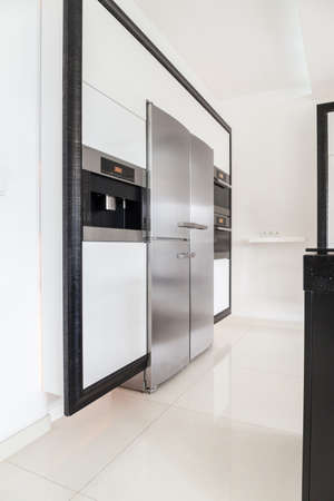 Big silver fridge in elegant kitchen photo