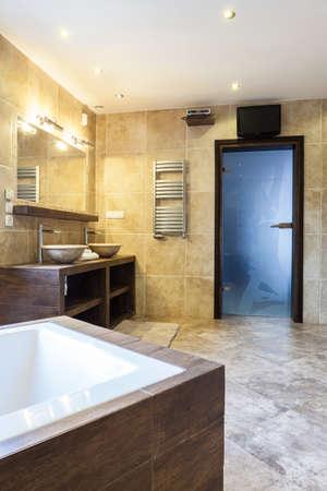 Spacious luxury bathroom with interior sauna