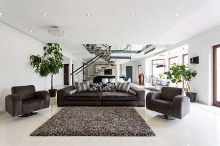 contemporary interior: Modern front room with marble floor Stock Photo