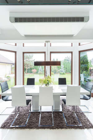 Photo of contemporary stylish main room with big table photo