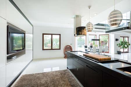 Modern elegant kitchen with home movie theater