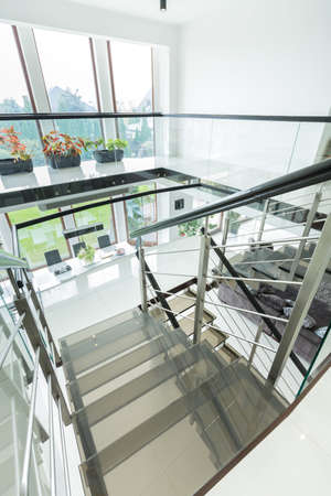 Vertical view of big extravagant stairway in luxury home photo