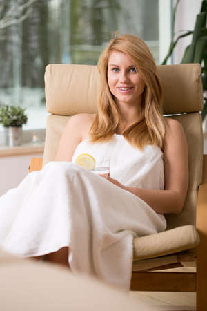Woman spending pleasant time in wellness center Stock Photo