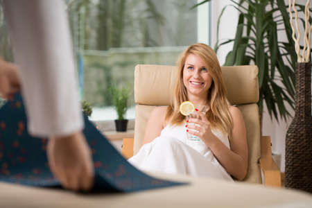 Image of attractive woman relaxing in wellness center Stock Photo
