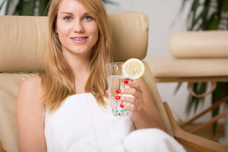 Beauty woman sitting on the chair in spa room
