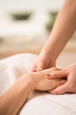 beautician: Close-up of female beautician doing hand massage Stock Photo