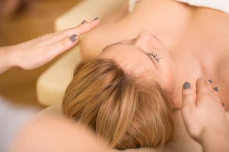 bioenergy therapy: Beauty blonde woman relaxing during reiki healing Stock Photo