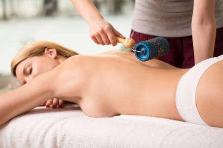 Beauty woman having massage done by massager