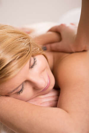 Close-up of woman having deep tissue massage done Stock Photo