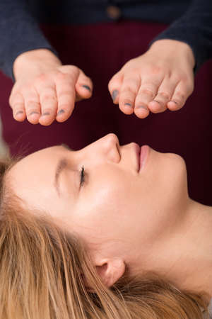bioenergy therapy: Portrait of woman in reiki healing session