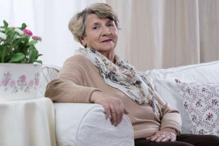 Beauty senior woman sitting on the sofa