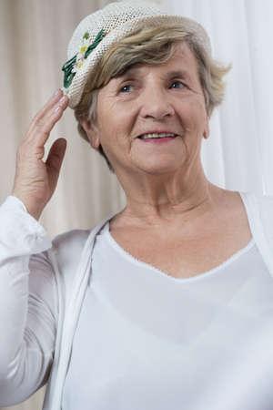 Portrait of happy retired woman in boater