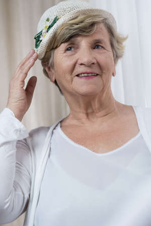 boater: Portrait of happy retired woman in boater