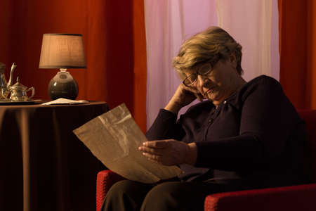 Picture of senior woman reading old letter