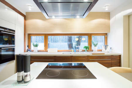 Electric hob on a white wheat in modern kitchen Stock Photo