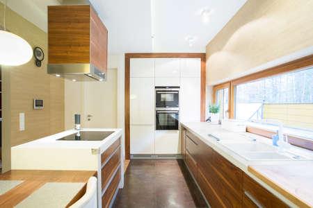 Spacious bright kitchen in modern house Stock Photo