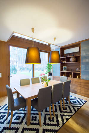Contemporary spacious dining room with fancy carpet Stock Photo