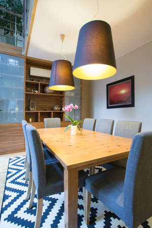View of wooden table inside modern interior Stock Photo