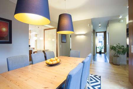 Spacious modern lounge with big eating table Stock Photo