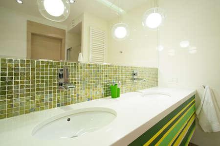 handbasin: Green small tiles in modern illuminated bathroom