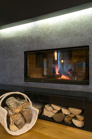woodburning: Close-up of modern burning fireplace in living room Stock Photo