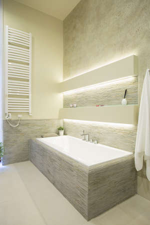 Close-up of bath in luxury illuminated bathroom Stock Photo