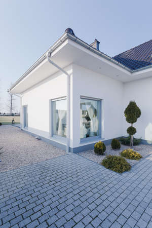 outside outdoor outdoors exterior: Detached house with white walls - view from the outside