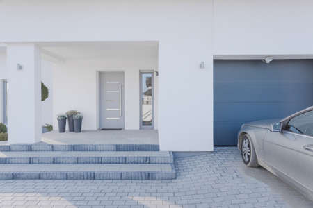 car door: Horizontal view of entrance to detached house