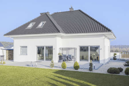 Exterior of beauty detached house at sunny day Standard-Bild