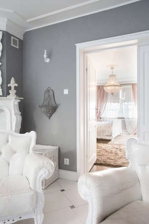 bedroom area: View of white furniture inside expensive house Stock Photo
