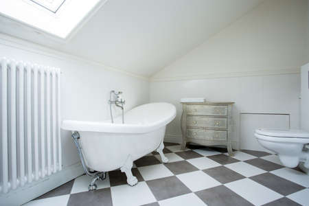 attic: View of bright bathroom in the attic