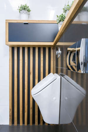 Toilet interior with urinar on the wall Stock Photo