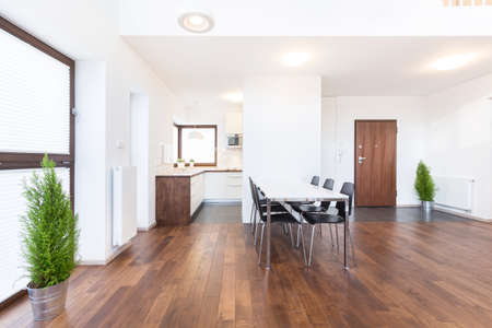 Wooden parquet and white walls in modern interior Stock Photo