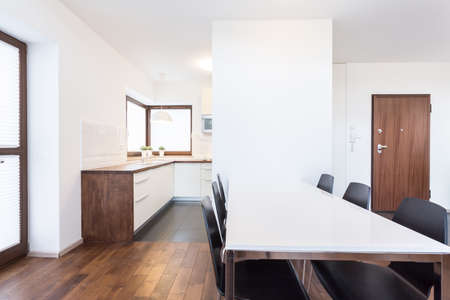 worktops: Open kitchen and dining room with white table