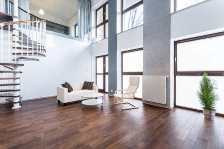 Horizontal view of white sofa in empty interior