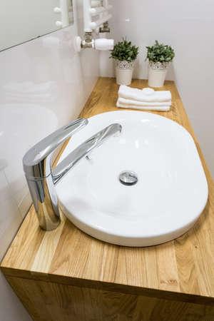 handbasin: Close-up of ceramic washbowl in modern bathroom Stock Photo