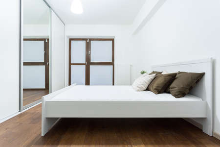 Bedroom interior in white and brown design Stock Photo