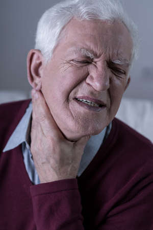 acute: Aged unhappy man with acute sore throat