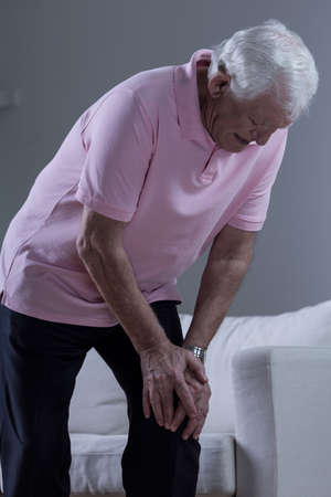 suffer: Senior sick man with painful osteoarthritis in his knee Stock Photo