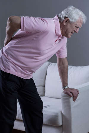 bad condition: Senior man with painful lumbar discopathy