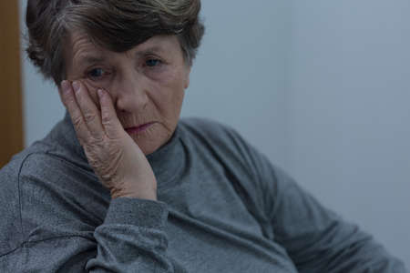 anxious: Portrait of senior woman suffering for depression