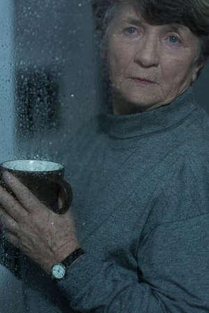 bad mood: Retired woman having bad mood in rainy day