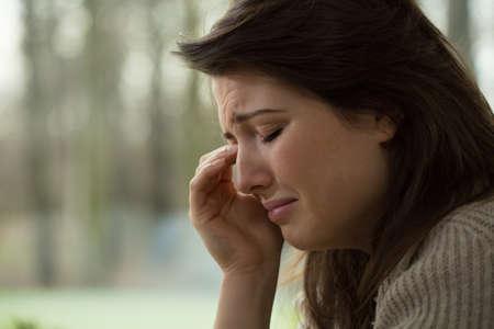 beautiful crying woman: Close-up of young melancholy sobbing woman