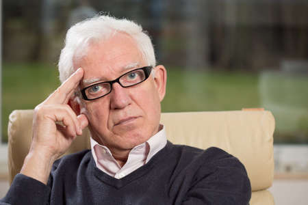 experienced: Image of senior concentrated psychotherapist in his office