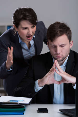business disagreement: Vertical view of disagreement in the office