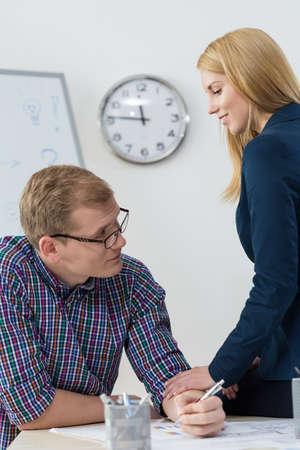 affair: View of friends having affair at work